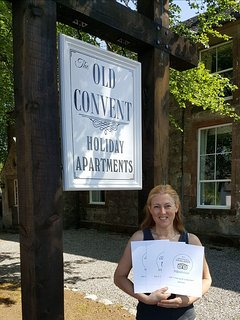 Felicity with certificates of excellence for all the apartments.