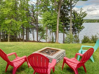 Lakefront, chalet-style home w/ large deck, a dock & beautiful lake views