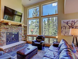 Large windows provide ample natural light for the living area