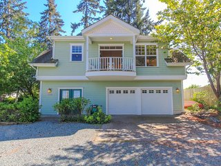 NEW LISTING! Peaceful home with lovely water views moments from beach and town