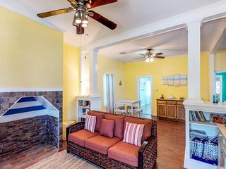 Dog-friendly bungalow with a front porch & full kitchen - blocks from the beach