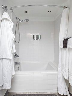 This newly updated alcove features a handheld multi-function showerhead and compact deep soaker tub.