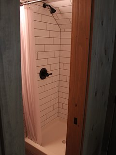 Custom shower with subway tiles.