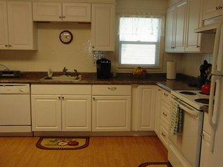 Complete large kitchen with dishwasher, range/oven, microwave, refrigerator, & Keurig coffeemaker.