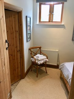 The single bedroom leading to an en suite shower room