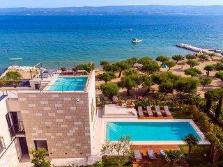 Brand new! Very luxury beachfront VILLA FLORES with heated outdoor & indoor pool
