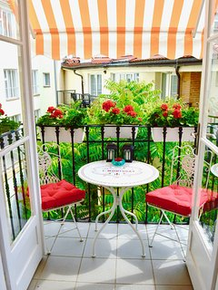 balcony overlooks quiet courtyard, ideal for alfresco dining