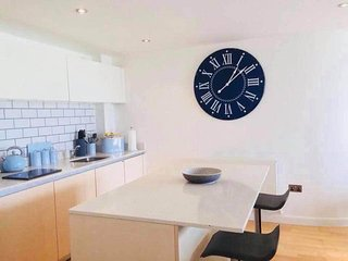 A contemporary beachside apartment less than a 5 min walk to beach (0.2) miles.