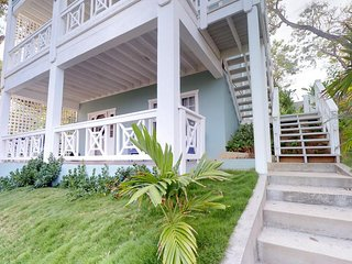 Breezy first-floor home with spacious porch only minutes away from beach!