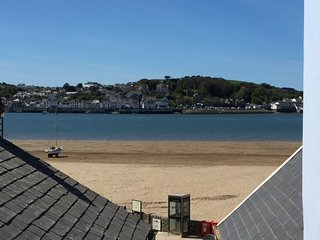 Holiday cottage situated yards from a sandy beach, pubs and a great restaurant.