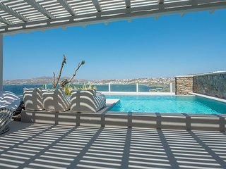 Relax in your private pool, gazing Mykonos town!