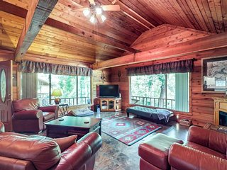 Riverfront dog-friendly home with canoe, dock, expansive deck, & prime location