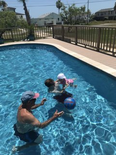 Guest enjoying the pool. Located in the lot next to the home. Rates in listing.