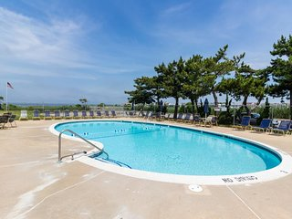 Bay-view condo with shared pool access steps from beach, shops, and restaurants!