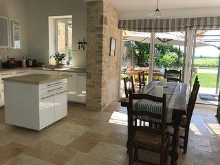 Kitchen, indoor dining area.