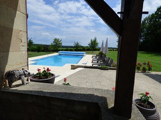 Looking out across the swimming pool from the bedroom terrace