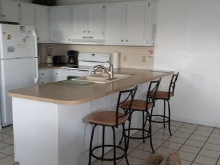 Full equipped kitchen. Unit has washer/dryer, central air, dishwasher, highest speed wireless.