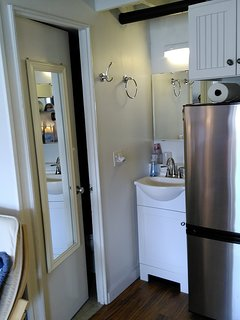 Vanity sink is  outside the toilet and shower room,