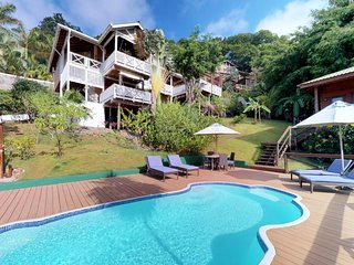 NEW LISTING! Tropical villa near the beach w/ balcony, views & shared pool