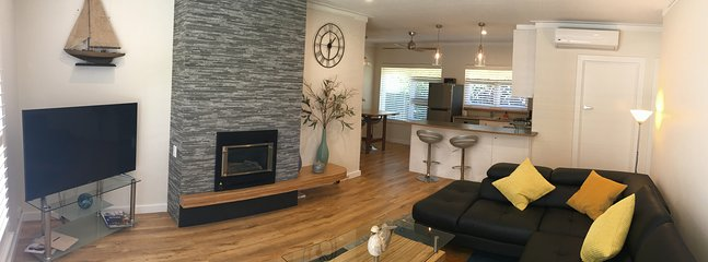 Spacious lounge kitchen dining gas log fire leather lounge Smart TV Free WiFi Air conditioning