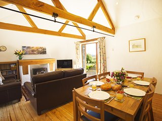 The open plan dining and living area has far reaching views over beautiful Cornish countryside.