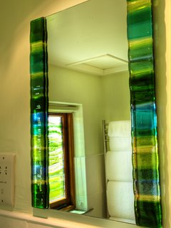 Jo Downs made the fused glass windows in both the bathrooms.