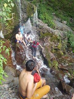 Hiking to the waterfalls near Sattal Lake