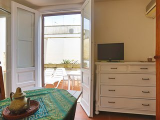Camera con terrazza privata in centro (uso cucina su richiesta)