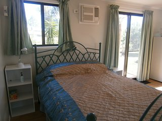 Cabin by the Burnett River in Sub-tropical Qld. Peaceful, private & romantic.