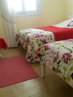Large bedroom with double bed and single bed
