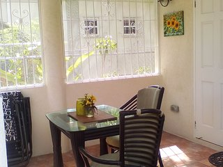 Covered, spacious out door patio with security grills and insect screens.
