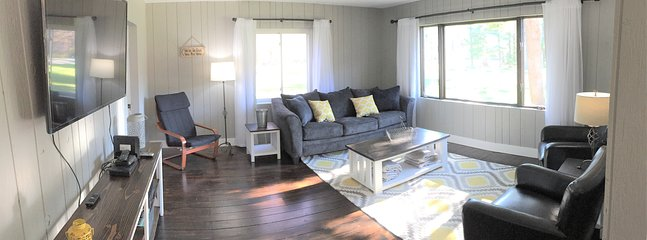 Living area with 55' smart tv, DVD player, stereo, games and queen sleeper sofa