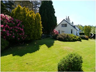 Detached house with stunning garden in picturesque coastal village S Scotland
