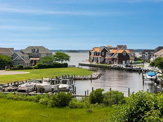 NEW LISTING! Luxury waterfront home w/bay views, shared pools & tennis courts