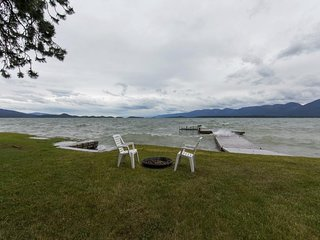 NEW LISTING! Waterfront cabin w/large yard, furnished deck, dock, & lake access