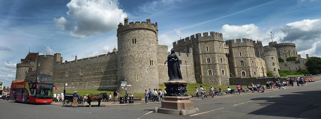 Aspect of Windsor Castle and monument of Queen Victoria taken from the high street