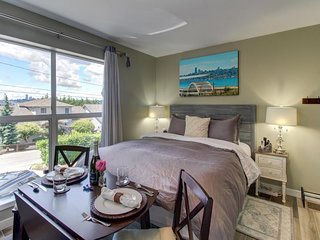 NEW LISTING! Cozy suite w/lake & city views, shared hot tub, near parks, dining