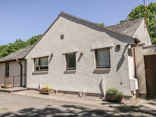 BLENG GARTH, all ground floor, woodburning stove, lawned garden with patio