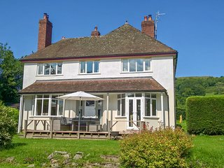 HILLSIDE, detached family home, woodburners, enclosed garden, pet-friendly, in
