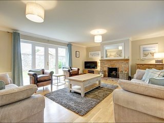 Lounge with open fire and French doors to the enclosed garden
