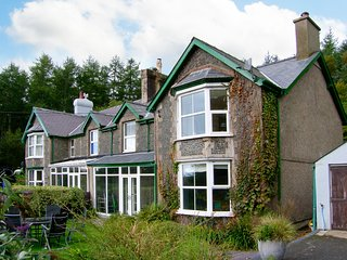 BRYN CWELLYN, semi-detached cottage, two woodburners, parking, acre of woodland