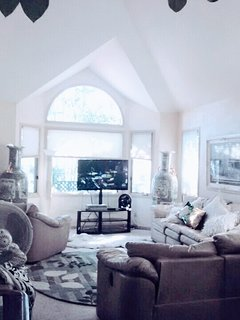 Family Room with high ceiling and TV