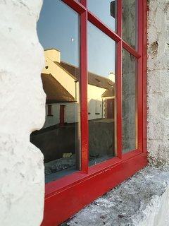 2018 and the last of the doors and windows in the yard are sympathetically replaced.