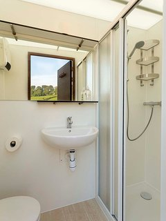 Toilet and shower cabin on site