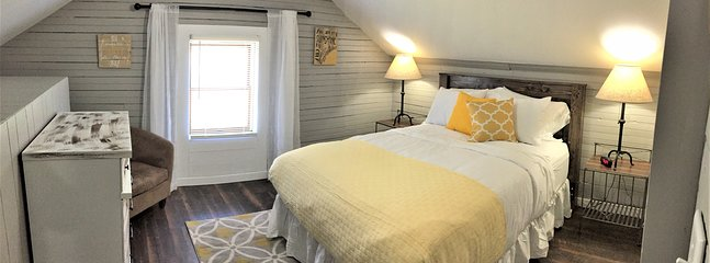 Queen bedroom (upstairs), has luxury mattress and featherbed top, also with pack n play