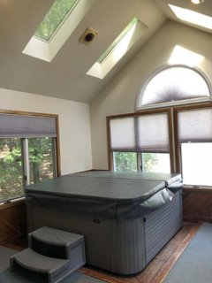 sun room with hot tub