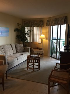 Living room with fantastic view of gulf, 50 inch tv, and extra storage dresser.