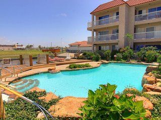 NEW LISTING! Modern poolside condo with shared pool and fishing docks!