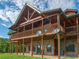 Spacious cabin w/ private hot tub, large wraparound deck, & mountain views