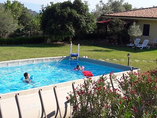 Villa with pool, big garden arounded by olives trees, near sea.